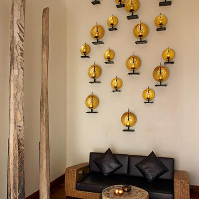 Candles resting on wall fixtures