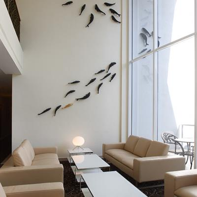 Shaols of bronze carp 'swimming' over the walls